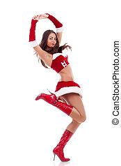 santa girl is jumping and dancing