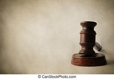 Gavel on Block with Aged Parchment Background - A dark...
