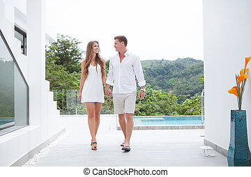 portrait of nice young couple in summer  villa  environment