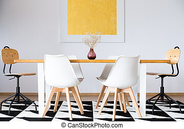 Symmetric dining room - Symmetric set of white chairs at...