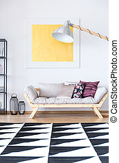Living room with geometric carpet - Gold painting above...