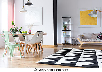 Bright room with geometric carpet - Lamps above decorative...