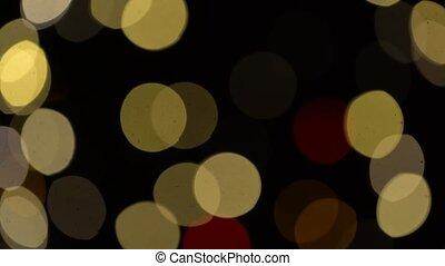blurred christmas lights over dark background - illumination...