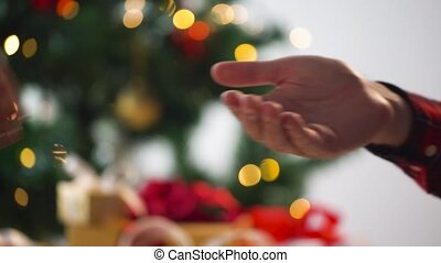 hands of couple with diamond ring at christmas - holidays,...