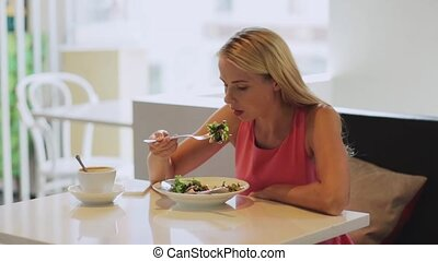 hungry woman eating salad for lunch at restaurant - food,...