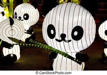 Panda Lanterns  - Image of lighted up panda lanterns.