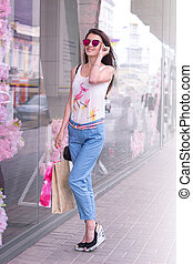 the charming slender women with packages from stores - the...
