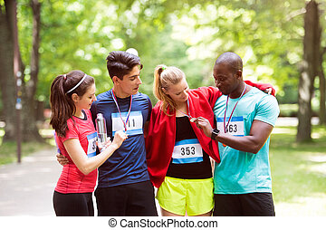 Group of young fit friends happy after finishing race. -...