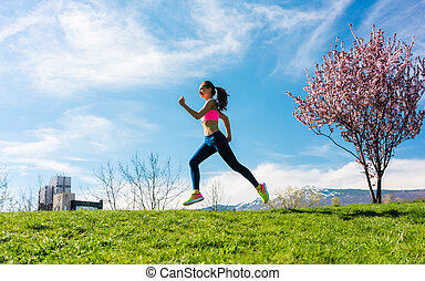 Woman sport running on hill for fitness