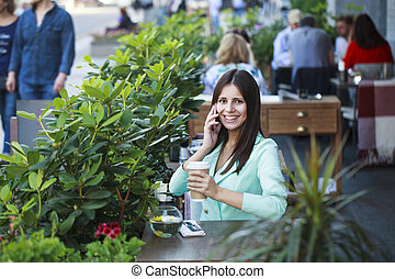 Young beautiful brunette woman ?sitting in a restaurant -...