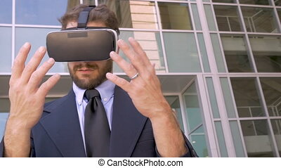 Handsome businessman in virtual reality augmented world with...