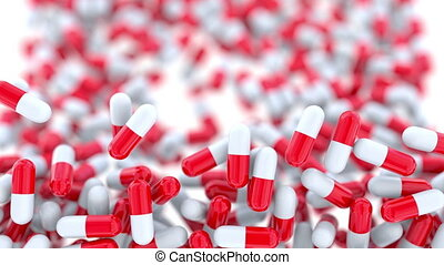 Falling drug capsules or pills, shallow focus. Alpha matte...