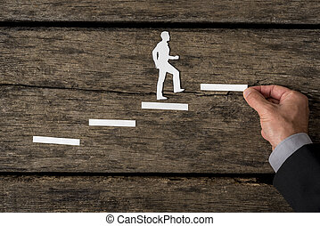 Creative concept of a successful businessman climbing the...
