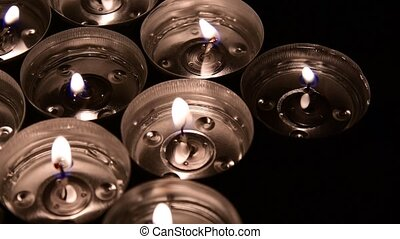 Group of burning tea light candles, rotating candles....