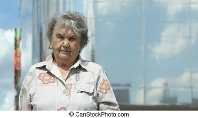 Portrait of serious old woman aged 80s outdoors - Portrait...