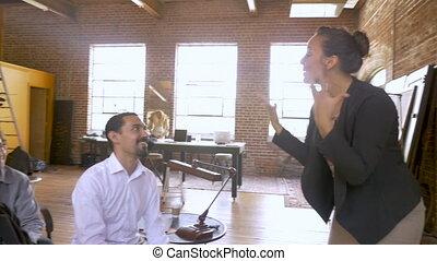 Businesswoman leads a presentation at motivational event...