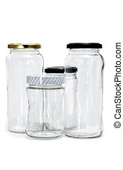 empty jars - some empty glass jars isolated on a white...