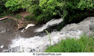big waterfall in forest - view from top of Dzhurynskyi...