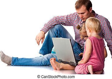 Father with children playing on laptop
