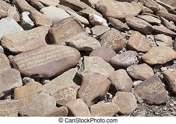 Mani stones at the Stok Palace, Ladakh, India - Mani stones...