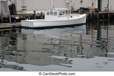 White lobster boat in harbor - White lobster boat in...