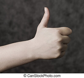 Thumbs up towards grey background