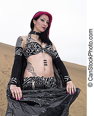 Vampire aspect woman and sand - Desert environement with...