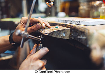 Goldsmith working and creating jewelry
