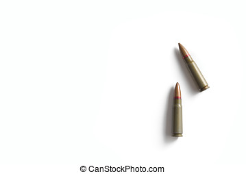 Two rifle bullets isolated on a white background. Military...
