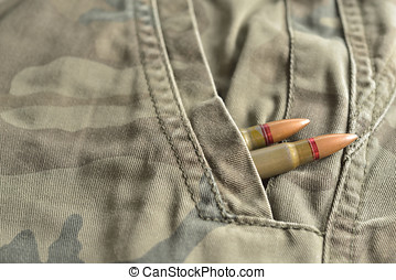 Two rifle bullets hidden into military camo pocket pants....