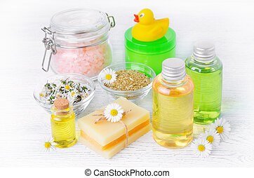 natural baby care products with chamomile oil, flowers...