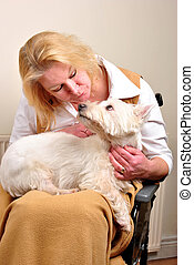 woman in a wheelchair is talking to her dog