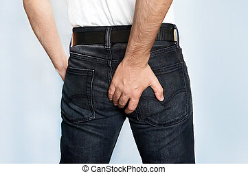 Man has Diarrhea Holding his Butt. Guy to hold with a hand a...