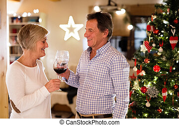 Beautiful senior couple celebrating Christmas together. -...