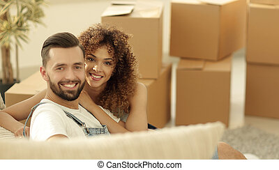 young couple in a new apartment. Concept of well-being -...
