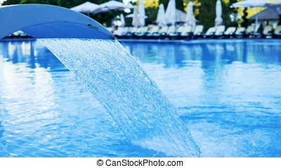 Slow motion of Water fountain treatment in the pool of...