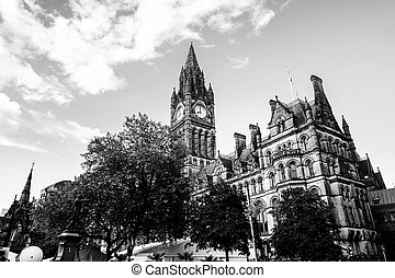 Manchester, UK. Town Hall with cloudy sky - Manchester, UK....