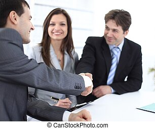 handshake business partners in the workplace - concept of...