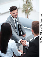 handshake business partners in the lobby of the office....
