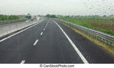 Traffic in heavy rainy day with road view inside the car...