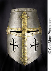 Iron helmet of the medieval knight Very heavy headdress