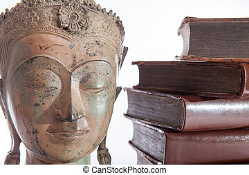 Philosophy and ethics. The philosopher Buddha statue and...