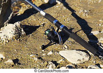 Fishing rod on the ground closeup