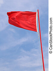 flying red flag indicating a state of danger and alarm - red...