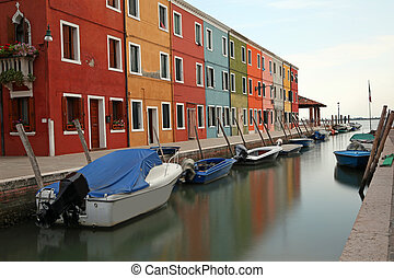 navigable canal and the colorful houses of the BURANO island...