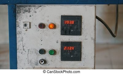Old scratched industry control panel on plant - producing of...