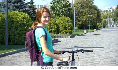 girl riding on a bike by the streets and at the city park