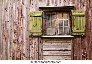 Old wooden window with shutters