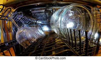 Inside view on washing of ware in the dishwasher - inside...