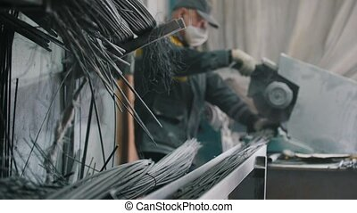 Worker cuts production on manufacturing of composite...